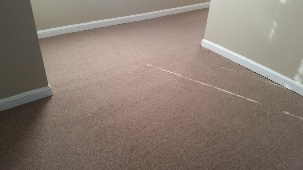 Berber carpet after seam repair to hallway in Louisville KY